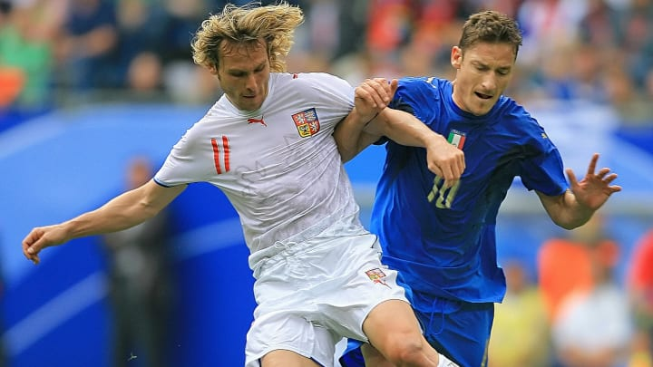 Czech midfielder Pavel Nedved (L) fights