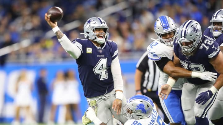 DETROIT, MI - NOVEMBER 17: Dak Prescott #4 of the Dallas Cowboys throws the ball while pressured by Mike Daniels #96 of the Detroit Lions in the fourth quarter at Ford Field on November 17, 2019 in Detroit, Michigan. (Photo by Rey Del Rio/Getty Images)