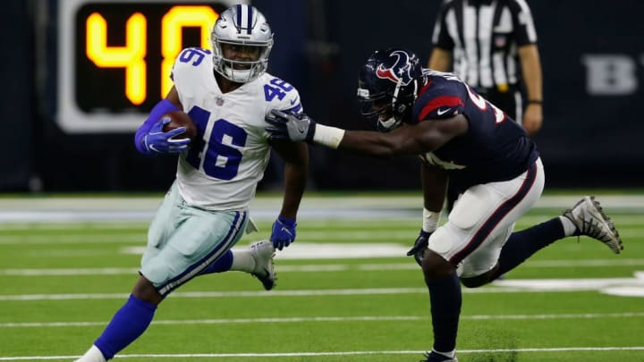 HOUSTON, TX - AUGUST 30:  Jordan Chunn #46 of the Dallas Cowboys rushes past Ufomba Kamalu #94 of the Houston Texans in the second half of the preseason game at NRG Stadium on August 30, 2018 in Houston, Texas.  (Photo by Tim Warner/Getty Images)