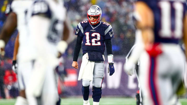 FOXBOROUGH, MA - NOVEMBER 24: Tom Brady #12 of the New England Patriots looks on during a game against the Dallas Cowboys at Gillette Stadium on November 24, 2019 in Foxborough, Massachusetts. (Photo by Adam Glanzman/Getty Images)