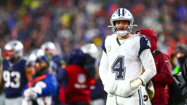 FOXBOROUGH, MA - NOVEMBER 24:   Dak Prescott #4 of the Dallas Cowboys reacts during a game against the New England Patriots at Gillette Stadium on November 24, 2019 in Foxborough, Massachusetts.  (Photo by Adam Glanzman/Getty Images)