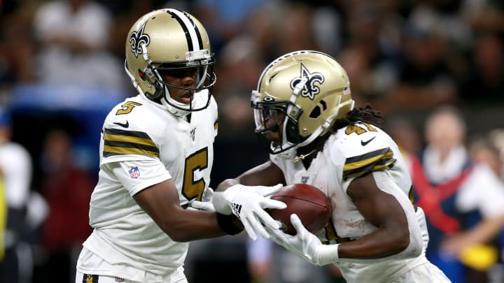 NEW ORLEANS, LOUISIANA - SEPTEMBER 29: Teddy Bridgewater #5 of the New Orleans Saints hands the ball off to Alvin Kamara #41 of the New Orleans Saints during the second half of a NFL game against the Dallas Cowboys at the Mercedes Benz Superdome on September 29, 2019 in New Orleans, Louisiana. (Photo by Sean Gardner/Getty Images)