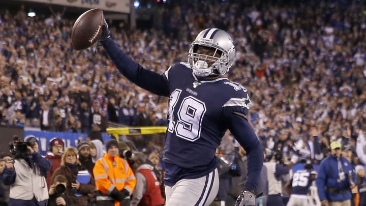 EAST RUTHERFORD, NEW JERSEY - NOVEMBER 04:  Amari Cooper #19 of the Dallas Cowboys celebrates his touchdown in the fourth quarter as Corey Ballentine #25 and Michael Thomas #31 of the New York Giants defends at MetLife Stadium on November 04, 2019 in East Rutherford, New Jersey.The Dallas Cowboys defeated the New York Giants 37-18. (Photo by Elsa/Getty Images)