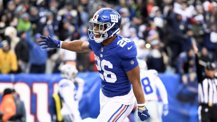EAST RUTHERFORD, NEW JERSEY - DECEMBER 30: Saquon Barkley #26 of the New York Giants reacts after scoring during the fourth quarter of the game against the Dallas Cowboys at MetLife Stadium on December 30, 2018 in East Rutherford, New Jersey. (Photo by Sarah Stier/Getty Images)