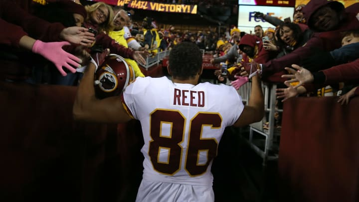 LANDOVER, MD - OCTOBER 21: Jordan Reed #86 of the Washington Redskins celebrates with fans after the Washington Redskins defeated the Dallas Cowboys at FedExField on October 21, 2018 in Landover, Maryland. (Photo by Will Newton/Getty Images)