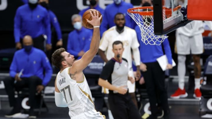 Luka Doncic lays it in.