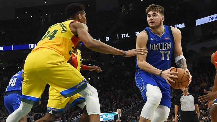MILWAUKEE, WISCONSIN - JANUARY 21:  Luka Doncic #77 of the Dallas Mavericks works against Giannis Antetokounmpo #34 of the Milwaukee Bucks during a game at Fiserv Forum on January 21, 2019 in Milwaukee, Wisconsin. NOTE TO USER: User expressly acknowledges and agrees that, by downloading and or using this photograph, User is consenting to the terms and conditions of the Getty Images License Agreement. (Photo by Stacy Revere/Getty Images)