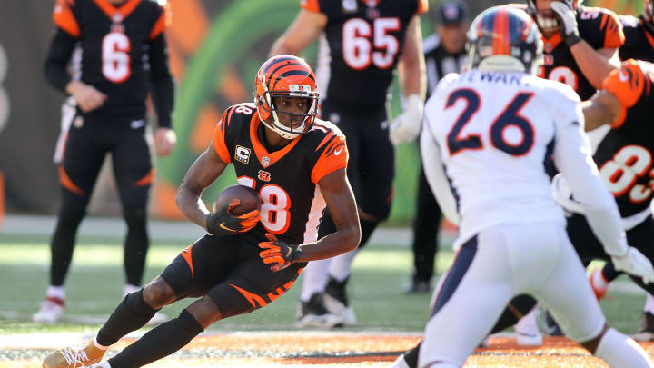 CINCINNATI, OH - DECEMBER 2:  A.J. Green #18 of the Cincinnati Bengals runs with the ball during the first quarter of the game against the Denver Broncos at Paul Brown Stadium on December 2, 2018 in Cincinnati, Ohio. (Photo by John Grieshop/Getty Images)