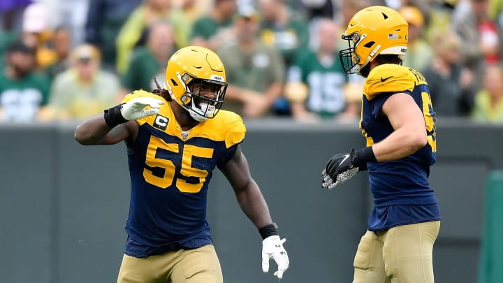 GREEN BAY, WISCONSIN - SEPTEMBER 22: Za'Darius Smith #55 of the Green Bay Packers celebrates with Kyler Fackrell #51 of the Green Bay Packers after his tackled in the fourth quarter against the Denver Broncos at Lambeau Field on September 22, 2019 in Green Bay, Wisconsin. (Photo by Quinn Harris/Getty Images)