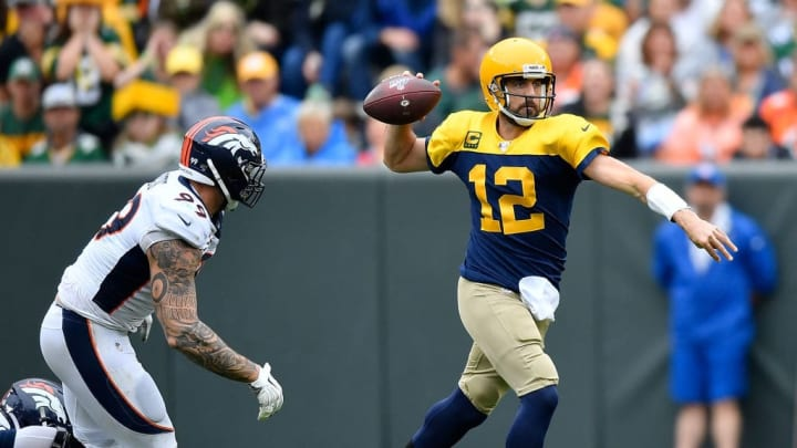 GREEN BAY, WISCONSIN - SEPTEMBER 22: Aaron Rodgers #12 of the Green Bay Packers looks to pass as Adam Gotsis #99 of the Denver Broncos pursues in the first quarter at Lambeau Field on September 22, 2019 in Green Bay, Wisconsin. (Photo by Quinn Harris/Getty Images)