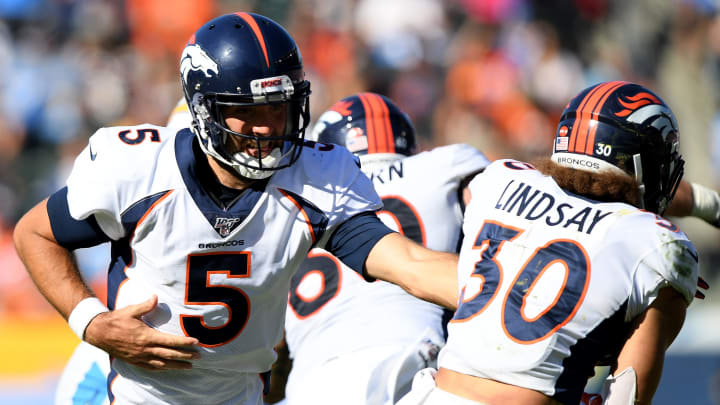 CARSON, CALIFORNIA - OCTOBER 06:  Joe Flacco #5 of the Denver Broncos hands off to Phillip Lindsay #30 during the third quarter in a 20-13 Broncos win over the Los Angeles Chargers at Dignity Health Sports Park on October 06, 2019 in Carson, California. (Photo by Harry How/Getty Images)