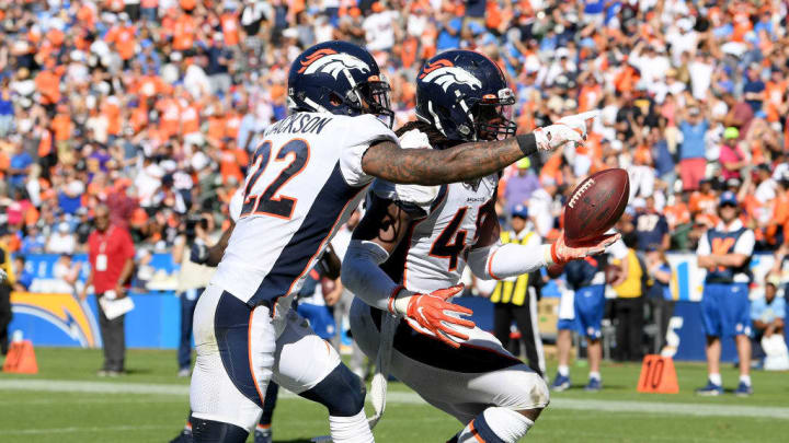 CARSON, CALIFORNIA - OCTOBER 06:  A.J. Johnson #45 of the Denver Broncos celebrates his interception in the endzone with Kareem Jackson #22 during the third quarter in a 20-13 Broncos win over the Los Angeles Chargers at Dignity Health Sports Park on October 06, 2019 in Carson, California. (Photo by Harry How/Getty Images)