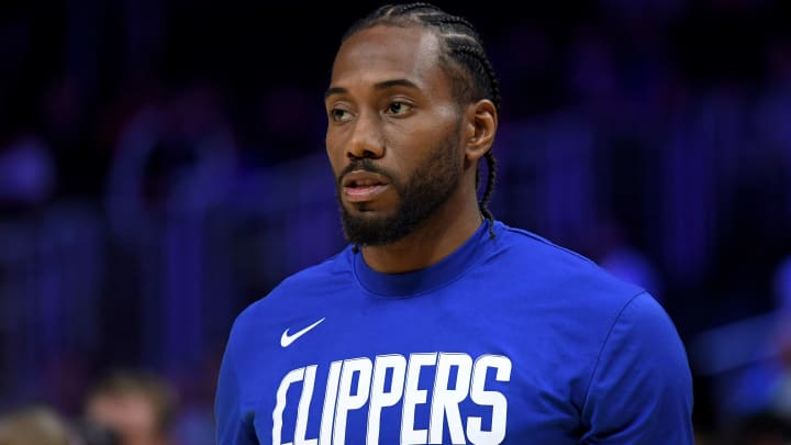 LOS ANGELES, CALIFORNIA - OCTOBER 10:  Kawhi Leonard #2 of the LA Clippers during warm up before a preseason game against the Denver Nuggets at Staples Center on October 10, 2019 in Los Angeles, California. (Photo by Harry How/Getty Images)