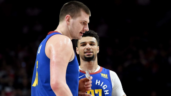 PORTLAND, OREGON - MAY 09: Nikola Jokic #15, speaks with Jamal Murray #27 of the Denver Nuggets during the second half of Game Six of the Western Conference Semifinals against the Portland Trail Blazers at Moda Center on May 09, 2019 in Portland, Oregon. The Blazers won 119-108. NOTE TO USER: User expressly acknowledges and agrees that, by downloading and or using this photograph, User is consenting to the terms and conditions of the Getty Images License Agreement. (Photo by Steve Dykes/Getty Images)