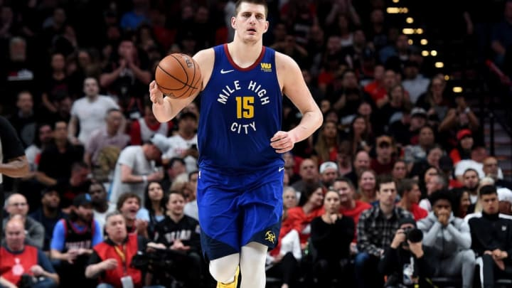 PORTLAND, OREGON - MAY 09: Nikola Jokic #15 of the Denver Nuggets brings the ball up the court during the second half of Game Six of the Western Conference Semifinals against the Portland Trail Blazers at Moda Center on May 09, 2019 in Portland, Oregon. The Blazers won 119-108. NOTE TO USER: User expressly acknowledges and agrees that, by downloading and or using this photograph, User is consenting to the terms and conditions of the Getty Images License Agreement. (Photo by Steve Dykes/Getty Images)