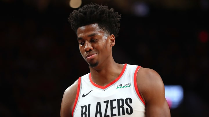 PORTLAND, OREGON - OCTOBER 23: Hassan Whiteside #21 of the Portland Trail Blazers reacts while heading to the bench in the fourth quarter against the Denver Nuggets during their season opener at Moda Center on October 23, 2019 in Portland, Oregon. NOTE TO USER: User expressly acknowledges and agrees that, by downloading and or using this photograph, User is consenting to the terms and conditions of the Getty Images License Agreement (Photo by Abbie Parr/Getty Images)