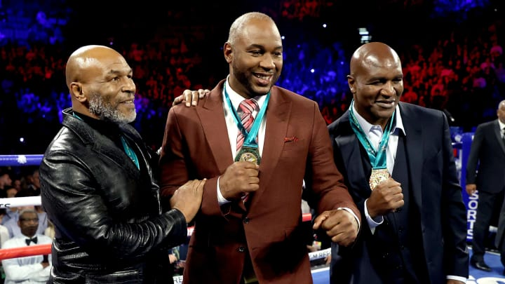 Mike Tyson, Lennox Lewis, Evander Holyfield