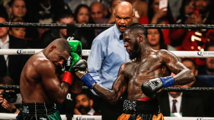 NEW YORK, NY - MARCH 03: Luis Ortiz (green shorts) and Deontay Wilder (yellow and black shorts) fight during their WBC Heavyweight Championship fight at Barclays Center on March 3, 2018 in the Brooklyn Borough of New York City. (Photo by Anthony Geathers/Getty Images)