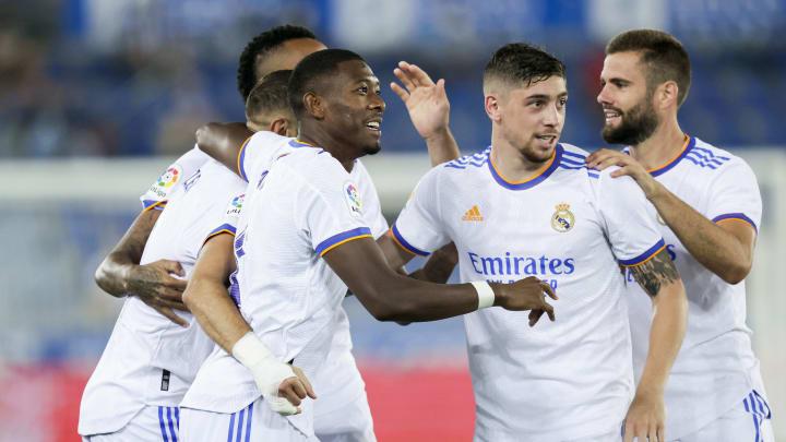 Karim Benzema gets congratulated for his brace