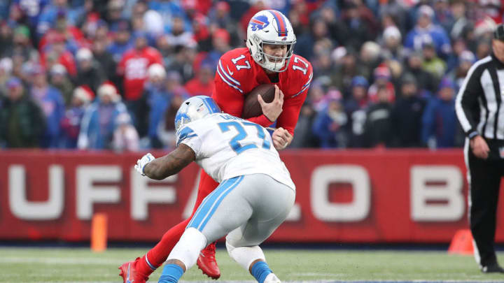 BUFFALO, NY - DECEMBER 16: Josh Allen #17 of the Buffalo Bills runs the ball in the fourth quarter during NFL game as he is stopped by Glover Quin #27 of the Detroit Lions at New Era Field on December 16, 2018 in Buffalo, New York. (Photo by Tom Szczerbowski/Getty Images)
