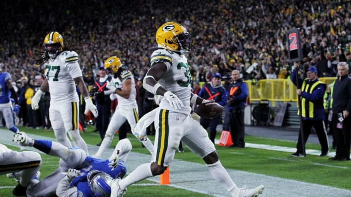 GREEN BAY, WISCONSIN - OCTOBER 14:  Jamaal Williams #30 of the Green Bay Packers scores a touchdown in the second quarter against the Detroit Lions at Lambeau Field on October 14, 2019 in Green Bay, Wisconsin. (Photo by Dylan Buell/Getty Images)