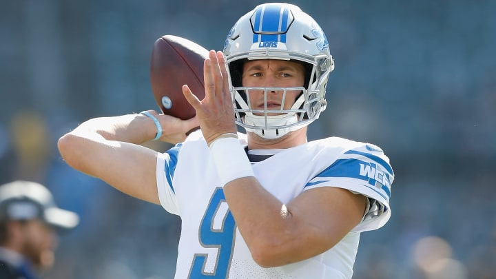 Matthew Stafford warms up against the Oakland Raiders.