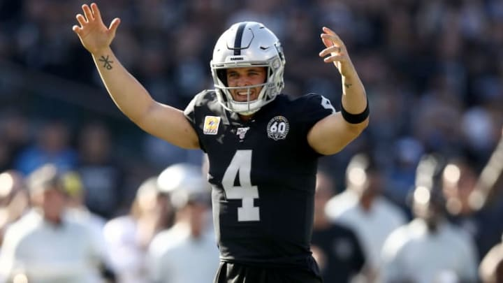 OAKLAND, CALIFORNIA - NOVEMBER 03:   Derek Carr #4 of the Oakland Raiders reacts after Josh Jacobs #28 ran in for a touchdown against the Detroit Lions at RingCentral Coliseum on November 03, 2019 in Oakland, California. (Photo by Ezra Shaw/Getty Images)