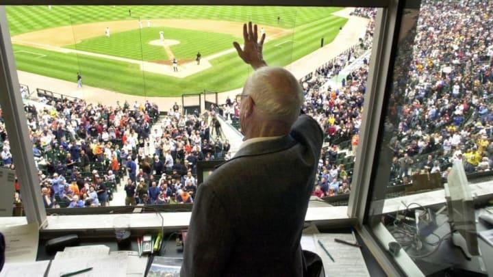 Detroit Tigers radio broadcaster Ernie Harwell waves