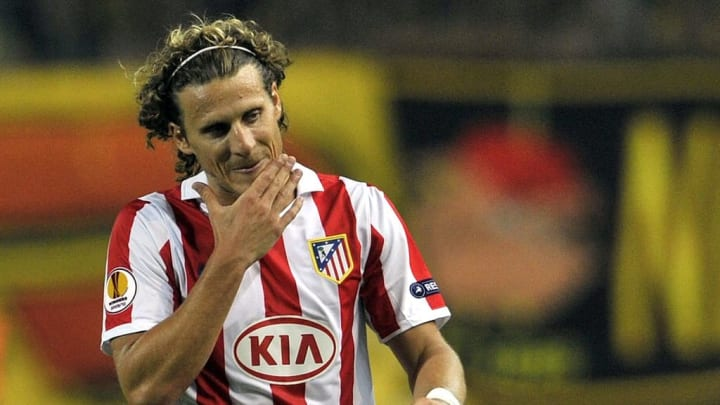 Diego Forlan of Atletico Madrid reacts d