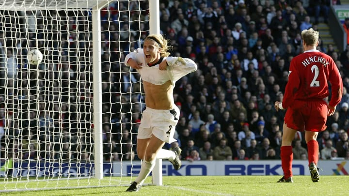 Diego Forlán of Manchester United celebrates scoring the first goal of the match