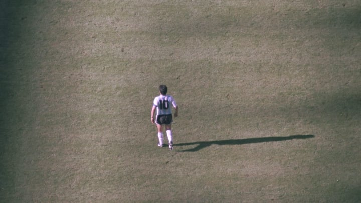 Diego Maradona of Argentina walking on the pitch during the Argentina v Cameroon match