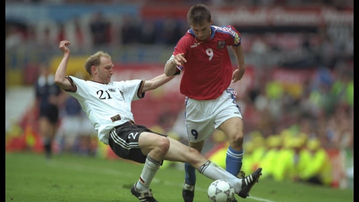 Dieter Eilts (left) of Germany tackles Pavel Kuka of the Czech Republic