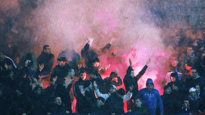 Dinamo Zagreb supporters lit flares duri
