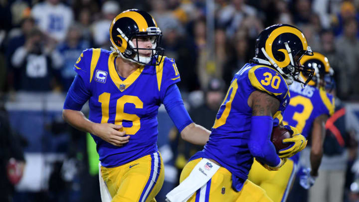 LOS ANGELES, CA - JANUARY 12: Jared Goff #16 of the Los Angeles Rams hands off to Todd Gurley #30 in the first quarter against the Dallas Cowboys in the NFC Divisional Playoff game at Los Angeles Memorial Coliseum on January 12, 2019 in Los Angeles, California.  (Photo by Harry How/Getty Images)