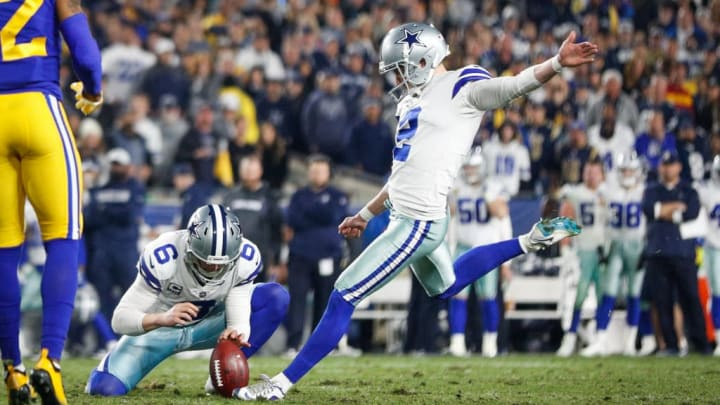 LOS ANGELES, CA - JANUARY 12: Kicker Brett Maher #2 of the Dallas Cowboys makes a point after a touchdown in the fourth quarter against the Los Angeles Rams to trail 30-22 in the NFC Divisional Round playoff game at Los Angeles Memorial Coliseum on January 12, 2019 in Los Angeles, California. (Photo by Meg Oliphant/Getty Images)