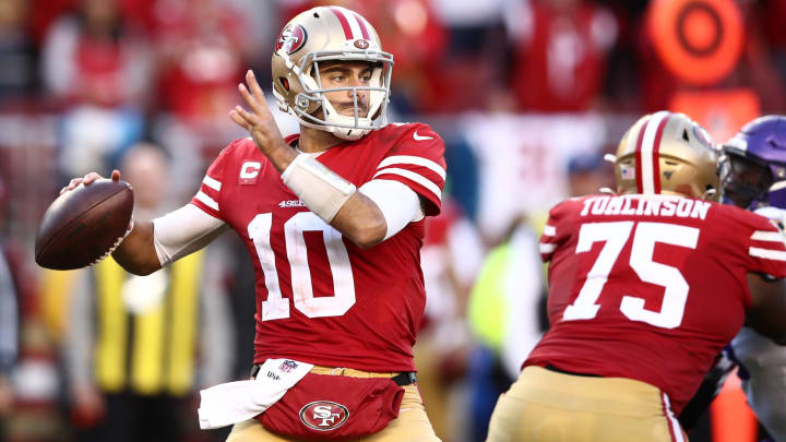 Jimmy Garoppolo attempts a pass in the NFC Divisional Round game against the Minnesota Vikings.