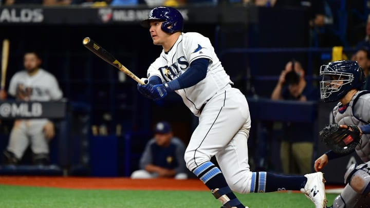 ST PETERSBURG, FLORIDA - OCTOBER 08:  Avisail Garcia #24 of the Tampa Bay Rays hits a single against the Houston Astros during the sixth inning in game four of the American League Division Series at Tropicana Field on October 08, 2019 in St Petersburg, Florida. (Photo by Julio Aguilar/Getty Images)
