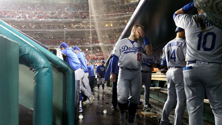 WASHINGTON, DC - OCTOBER 07: Max Muncy #13 of the Los Angeles Dodgers walks in the dug out during the eighth inning of game four of the National League Division Series against the Washington Nationals at Nationals Park on October 07, 2019 in Washington, DC. (Photo by Rob Carr/Getty Images)