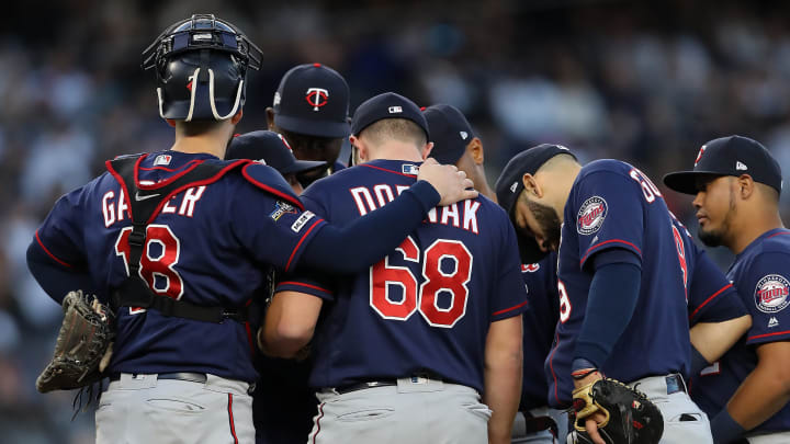 NEW YORK, NEW YORK - OCTOBER 05: Randy Dobnak #68 of the Minnesota Twins stands with teammates before being pulled by Rocco Baldelli #5 after loading the bases in the third inning in game two of the American League Division Series at Yankee Stadium on October 05, 2019 in New York City. (Photo by Elsa/Getty Images)