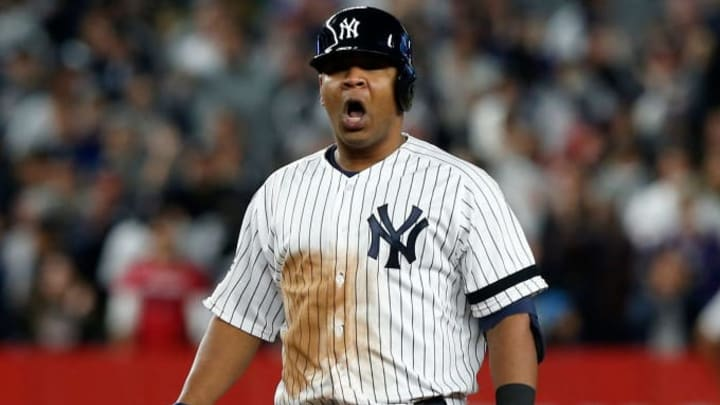 NEW YORK, NEW YORK - OCTOBER 04:   (NEW YORK DAILIES OUT)   Edwin Encarnacion #30 of the New York Yankees reacts at second base after his third inning RBI double against the Minnesota Twins in game one of the American League Division Series at Yankee Stadium on October 04, 2019 in New York City. The Yankees defeated the Twins 10-4.  (Photo by Jim McIsaac/Getty Images)