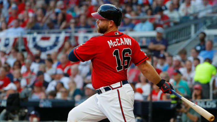 ATLANTA, GEORGIA - OCTOBER 04: Brian McCann #16 of the Atlanta Braves hits a single in the seventh inning in game two of the National League Division Series at SunTrust Park on October 04, 2019 in Atlanta, Georgia. (Photo by Kevin C. Cox/Getty Images)