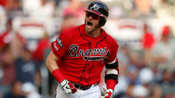 ATLANTA, GEORGIA - OCTOBER 04: Josh Donaldson #20 of the Atlanta Braves reacts after an RBI single off Jack Flaherty #22 of the St. Louis Cardinals in the first inning in game two of the National League Division Series at SunTrust Park on October 04, 2019 in Atlanta, Georgia. (Photo by Todd Kirkland/Getty Images)