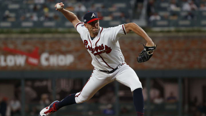 ATLANTA, GEORGIA - OCTOBER 09:  Darren O'Day #56 of the Atlanta Braves delivers the pitch against the St. Louis Cardinals during the eighth inning in game five of the National League Division Series at SunTrust Park on October 09, 2019 in Atlanta, Georgia. (Photo by Kevin C. Cox/Getty Images)