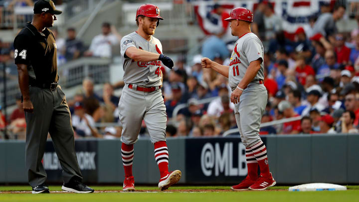 ATLANTA, GEORGIA - OCTOBER 03:  Harrison Bader #48 of the St. Louis Cardinals is congratulated by first base coach Stubby Clapp #11 after hitting an infield single against the Atlanta Braves during the fifth inning in game one of the National League Division Series at SunTrust Park on October 03, 2019 in Atlanta, Georgia. (Photo by Kevin C. Cox/Getty Images)