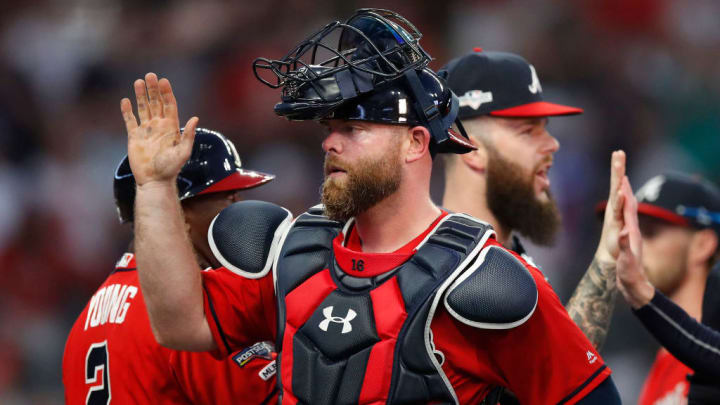 ATLANTA, GEORGIA - OCTOBER 04: Brian McCann #16 of the Atlanta Braves celebrate with his team after defeating the St. Louis Cardinals 3-0 in game two of the National League Division Series at SunTrust Park on October 04, 2019 in Atlanta, Georgia. (Photo by Todd Kirkland/Getty Images)