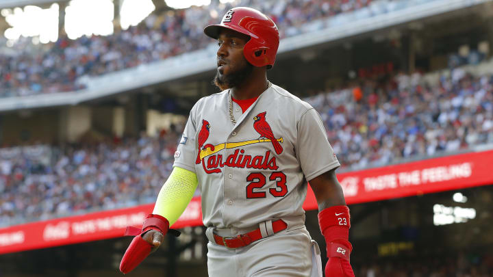 ATLANTA, GEORGIA - OCTOBER 09:  Marcell Ozuna #23 of the St. Louis Cardinals celebrates after scoring a run on a double by teammate Tommy Edman (not pictured) against the Atlanta Braves during the first inning in game five of the National League Division Series at SunTrust Park on October 09, 2019 in Atlanta, Georgia. (Photo by Kevin C. Cox/Getty Images)