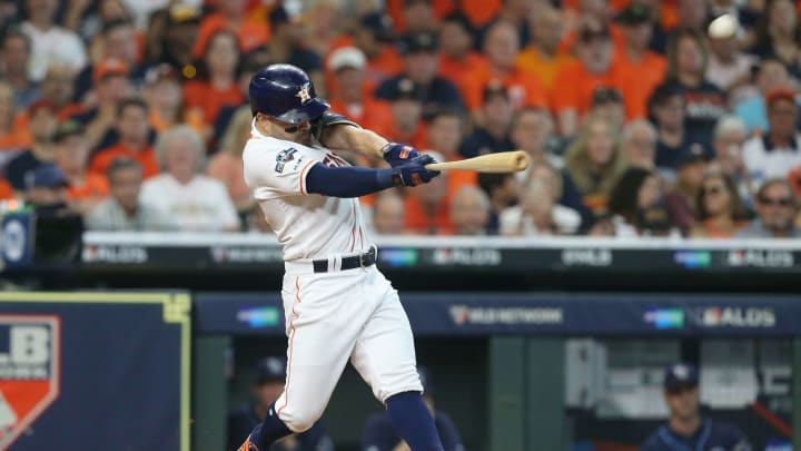 HOUSTON, TEXAS - OCTOBER 04:  Jose Altuve #27 of the Houston Astros hits a two-run home run off of Tyler Glasnow #20 of the Tampa Bay Rays (not pictured) during the fifth inning in game one of the American League Division Series at Minute Maid Park on October 04, 2019 in Houston, Texas. (Photo by Bob Levey/Getty Images)