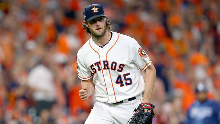 HOUSTON, TEXAS - OCTOBER 10:  Gerrit Cole #45 of the Houston Astros reacts after striking out Willy Adames (not pictured) #1 of the Tampa Bay Rays during the fifth inning in game five of the American League Division Series at Minute Maid Park on October 10, 2019 in Houston, Texas. (Photo by Bob Levey/Getty Images)