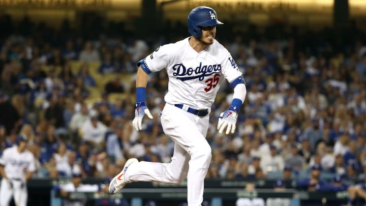 LOS ANGELES, CALIFORNIA - OCTOBER 09: Cody Bellinger #35 of the Los Angeles Dodgers runs to first on an error in the third inning of game five of the National League Division Series against the Washington Nationals at Dodger Stadium on October 09, 2019 in Los Angeles, California. (Photo by Sean M. Haffey/Getty Images)
