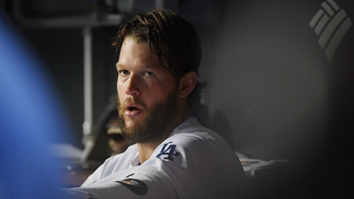 LOS ANGELES, CALIFORNIA - OCTOBER 04: Clayton Kershaw #22 of the Los Angeles Dodgers sits in the dugout at the end of the second inning in game two of the National League Division Series against the Washington Nationals at Dodger Stadium on October 04, 2019 in Los Angeles, California. (Photo by Harry How/Getty Images)